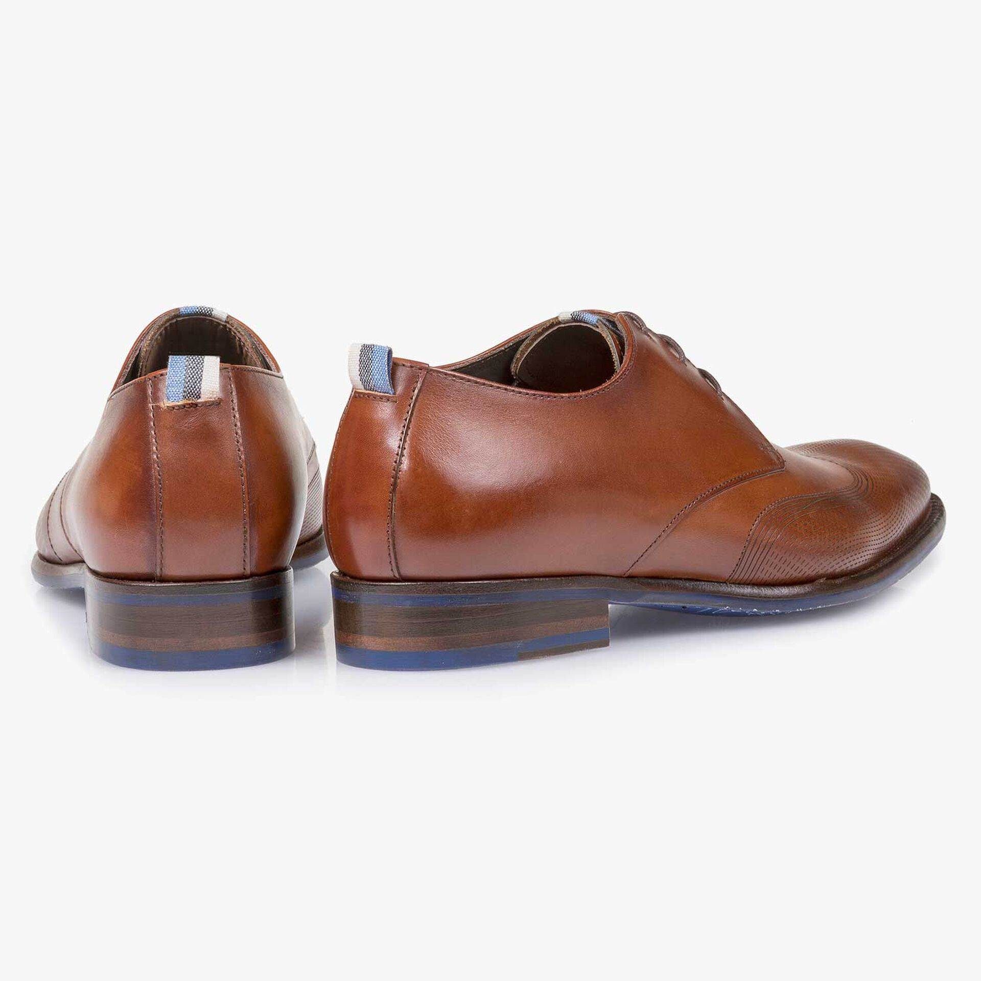 Cognac-colored calf leather lace shoe with a laser-cut pattern