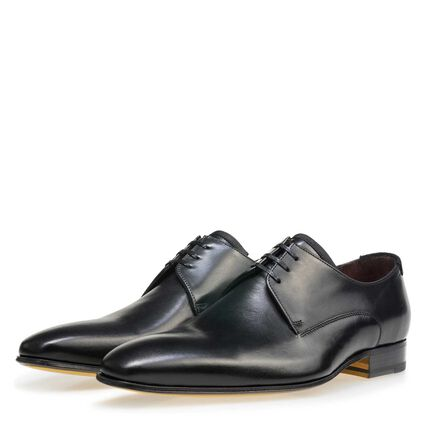 Leather lace-up shoe with yellow sole