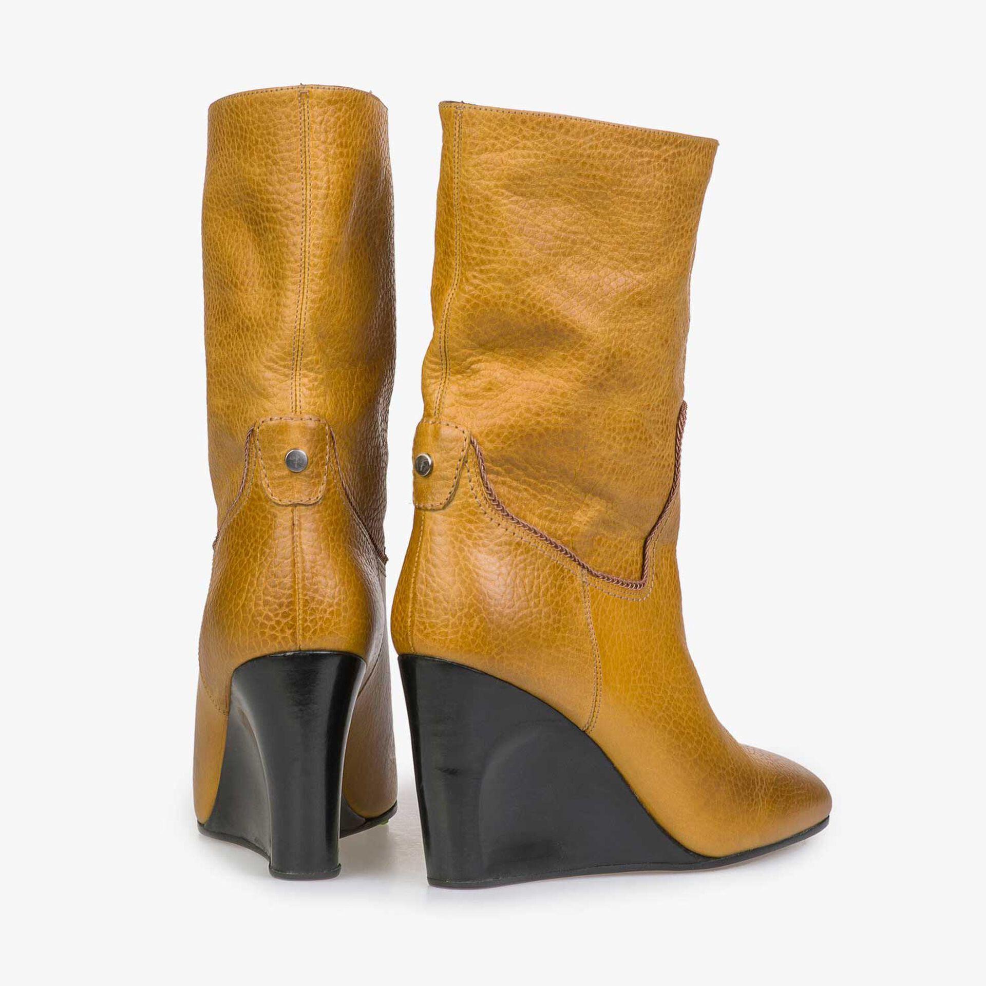 Mid-high mustard yellow wedge heel boots