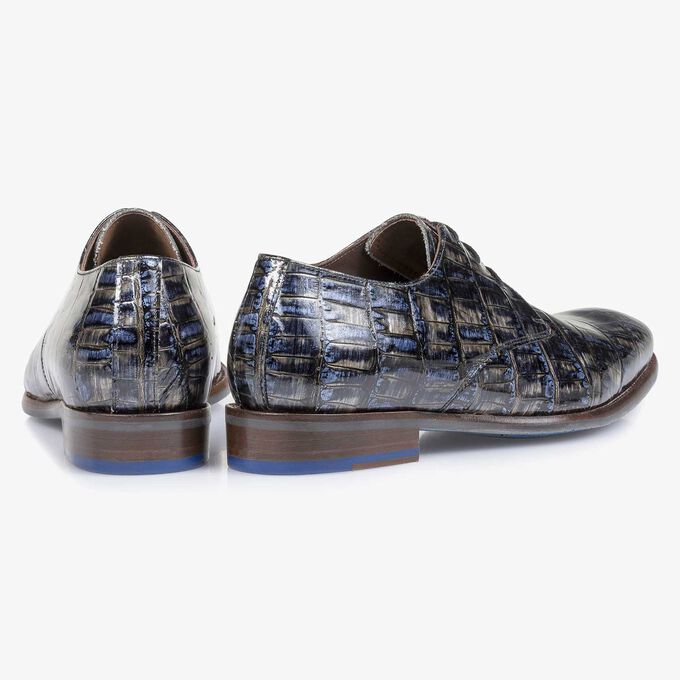 Grey patent leather lace shoe with a croco print