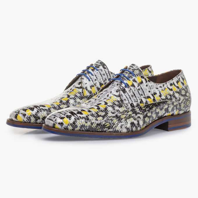 Yellow patent leather lace shoe with snake print
