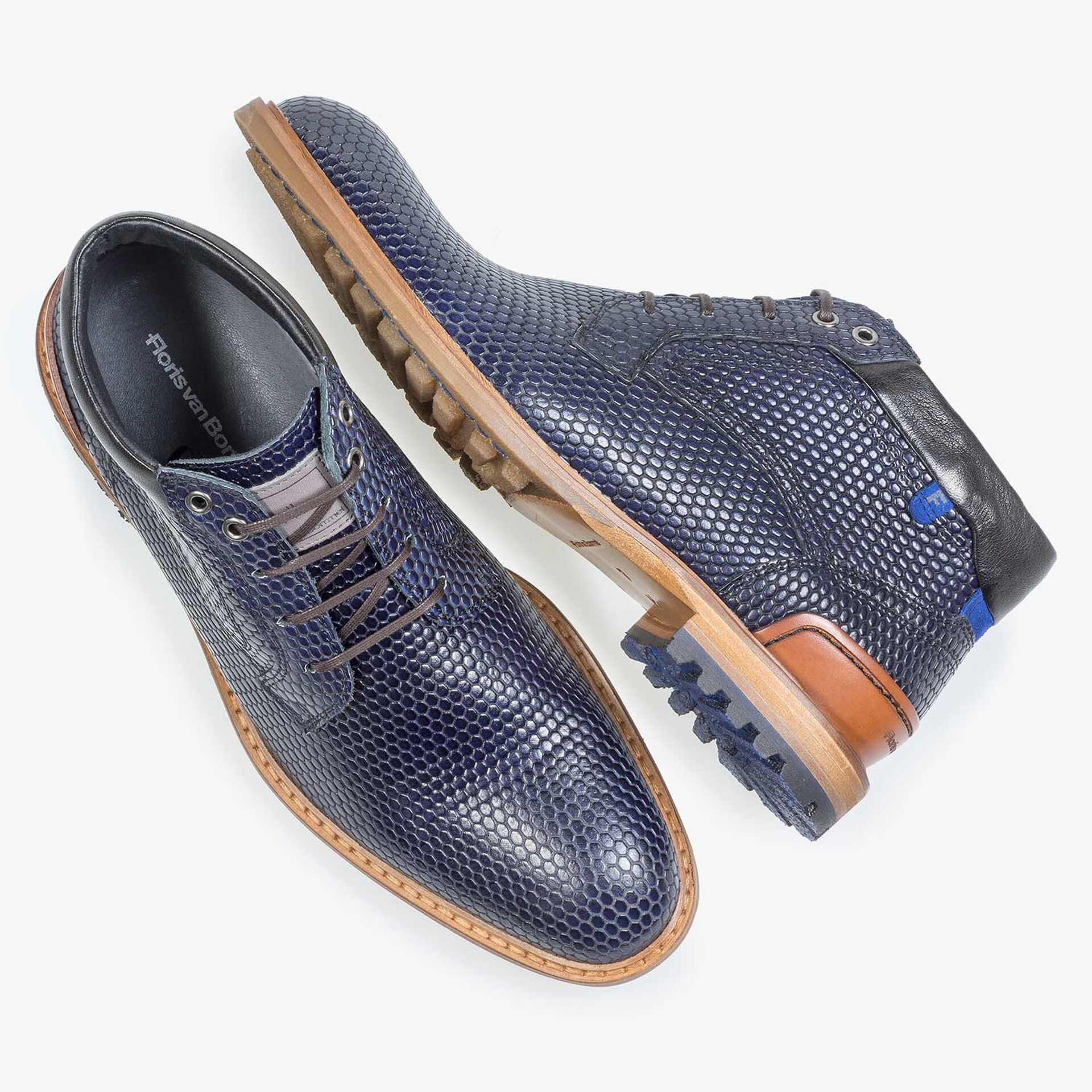 Dark blue leather lace boot with a structural print