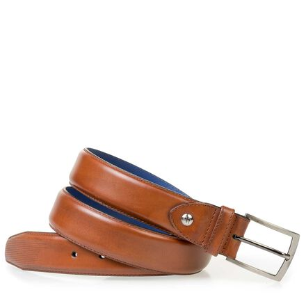 Leather belt with a laser-cut pattern