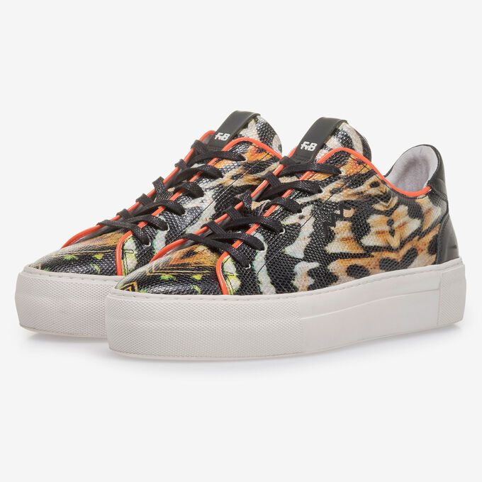 Black leather sneaker with orange-coloured print