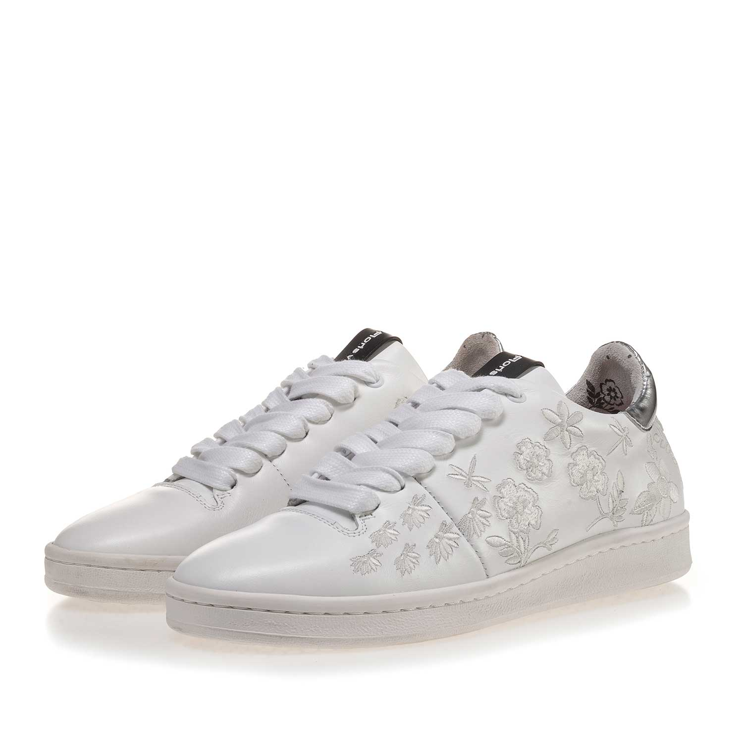 85235/01 - White leather sneaker with floral embroidery stitching